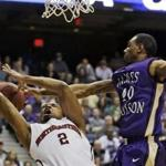 James Madison guard Devon Moore blocked a shot by Northeastern guard Demetrius Pollard in the first half.