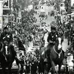 March 17, 1974: Boston's Mounted Police Unit led the parade up East Broadway. A highlight of the 1974 parade was a team of eight Anheuser-Busch Clydesdale horses pulling an open red wagon. They are just coming into view at the top of the picture.