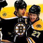 Zdeno Chara's first-period goal was a welcome sight to rookie Dougie Hamilton (right).
