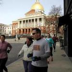 Brian McCarthy lead a City Running Tours group downtown.