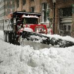 A plow pushed deep snow on State Street on Feb. 9. The city's side streets were harder to clear.