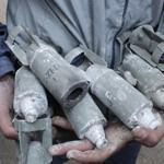 An inquiry found Syria is using more cluster bombs, which often don't explode on impact and later injure civilians.