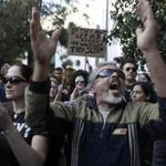 Protesters gathered outside the parliament in Nicosia, Cyprus, on Monday.