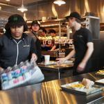 Employees of the Chestnut Hill Shake Shack were busy preparing for Wednesday's grand opening.