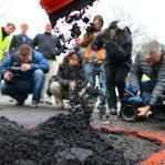 Boston officials and representatives of three pavement material companies assembled on Bowdoin Avenue in Dorchester Thursday for a demonstration of products for fixing potholes.