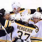 It was a group hug for the Bruins after Dennis Seidenberg (far left) scored from the point with 1:04 left in the third.