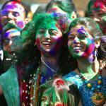 Participants splashed each other with bright colors for the Hindu holiday of Holi (festival of colors), held by the Braj Mandir Hindu Temple at the South Elementary School in Holbrook.