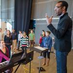 Artistic director Anthony Trecek-King works with the Boston Children's Chorus at the Institute of Contemporary Art, with accompanist Sarah Koonce.