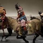 Samurai warriors on taxidermy horses. Left: Circa 1630 flame helmet of iron and gold.