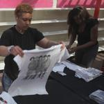 Noemi Torres and Sieauna Stoute prepared for the opening of 1D World, a pop-up store dedicated to the band One Direction.