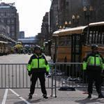 School buses lined both sides of Boylston Street where the street was locked down following the explosions. The area was transformed from the finish line to a crime scene.
