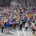 Thousands of runners were suddenly stopped by police and race officials on Commonwealth Avenue because of two bomb explosions at the finish line of the Boston Marathon.