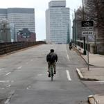 A lone bicyclist made his way across the Longfellow Bridge on Friday amid the lockdown.