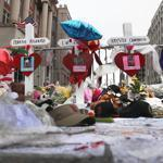Crosses and other items honored victims at a makeshift memorial on Berkeley Street in Boston on Saturday.