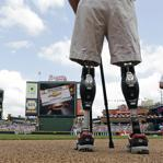 US Army Captain Dan Berschinski stands on prosthetic legs before a Braves game in Atlanta last year. Berschinski lost both legs to an IED blast while serving in Afghanistan in 2009.