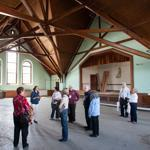 UMass Amherst alumni toured the long-closed Old Chapel on Friday. Repairs could cost as much as $20 million.