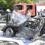 The charred remains of a car following the bomb attack on Prime Minister Wael al-Halqi of Syria in Damascus.