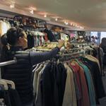 Kevin Kish chatted with regular customer Sherry Kelly at his consignment store, The Closet, on Newbury Street in Boston.