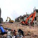 Excavators cleared debris as Bangladeshi rescue and army personnel continued recovery operations at the site of the eight-stoey building collaps on the outskirts of Dhaka.