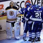 Maple Leafs players celebrate after Dion Phaneuf (closest to Bruins goalie Tuukka Rask) put Toronto ahead for good just 1:48 into the third period.