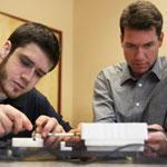 Joe Lane (right) worked with engineering intern Alexander Rick at UMass Lowell. Lane got an MBA at Babson.