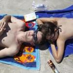 Experts caution against using sunscreen alone; hats and shade help a lot.