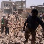 Syrians inspected the rubble of buildings damaged by government airstrikes in the city of Qusair on Saturday.