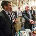 Senate candidate Gabriel Gomez (left) and Senator John McCain (center) greeted veteran  Thomas Hudner during a fund-raiser at the Fairmont Copley Hotel Monday.