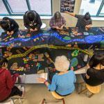 Participants worked on the Mending Boston quilt project at the Boston Asian Youth Essential Service in Chinatown. They were among the first people to work on the project.