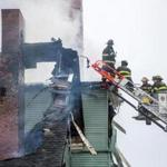 Firefighters worked the scene of a fire at the Seventh-Day Adventist Church in Lynn.