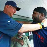 Terry Francona (left) returned to Fenway Park as the manager of the Cleveland Indians, his first game in the visiting dugout since leaving Boston. He greeted David Ortiz (right) just after a pregame session with the media.