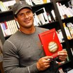Former baseball player and author Jose Canseco signed copies of his book