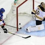 Derek Stepan scores on a wraparound, beating Bruins goalie Tuukka Rask after stealing the puck from Zdeno Chara behind the net.