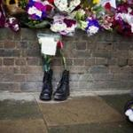 Military boots were placed outside Woolwich Barracks in London to pay tribute to Lee Rigby, a British soldier who was killed in a bloody attack Wednesday on a nearby street. Several suspects have been arrested in the killing.