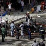Security forces inspected the scene of a car bomb attack on Sadoun Street in downtown Baghdad Monday.