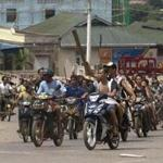 Buddhists armed with sticks rode through Lashio, where at least one person died in anti-Muslim unrest.