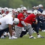 New England Patriots stretched during practice on May 29.