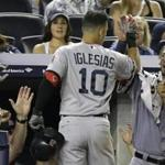 Jose Iglesias is greeted by Jarrod Saltalamacchia after Iglesias's solo homer in the fifth.