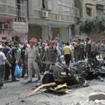 Syrians looked at the wreckage of the vehicle in the Adawiya district of Homs on Saturday.