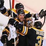 Goalie Tuukka Rask celebrated with Dennis Seidenberg, Brad Marchand, and Patrice Bergeron as a somber Sidney Crosby skated by after the Bruins beat the Penguins, 1-0, Friday.