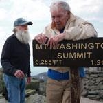 Harold Addison grabbed the summit sign as Gerry Wright, his climbing companion that night, and savior Guy Gosselin approached.