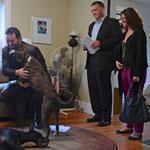 Brian Rosen played with Autumn, a home seller's pet, as wife Elizabeth Deutsch and broker Ed Greable watched.