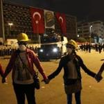 Demonstrators formed a human chain in front of security forces at Taksim square in Istanbul.
