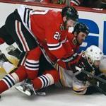 Brandon Saad (top) and Dave Bolland did their best to keep Rich Peverley down.