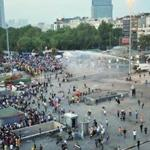 Riot police use a water cannon and tear gas to disperse protesters at the Gezi park near Taksim square in Istanbul