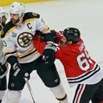 Andrew Shaw (right), tangling with 6-9 Zdeno Chara in Game 1, relishes his role of master provocateur for Chicago. Much like Brad Marchand (left)  of the Bruins.