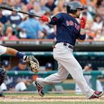 Shane Victorino, who tied a career high with five RBIs, belts a two-run single in the Sox' four-run fourth inning.