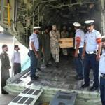 Pakistani air force personnel carried coffins of foreign tourists as they are unloaded upon arrival at an airbase.