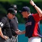 Red Sox manager John Farrell (right) argued with umpire Mike DiMuro after he ruled that Daniel Nava did not catch a fly ball in the eighth inning.