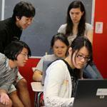 Students in a Winchester High computer science class looked at programming code on the screen of Erica Yuen.